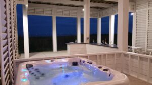 Ground floor: hot tub, summer bar, and outdoor sofa